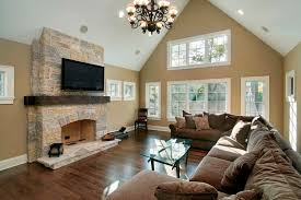 wall colors for family room antique chandelier for cozy family room ideas with stone fireplace