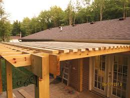 pergola with inset beams and 2x4 louvers instead of lattice board
