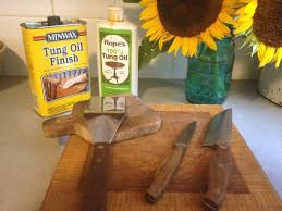 how to make your wood cutting board last forever wood cutting boards and kitchen utensils can be treated with tung oil so they look beautiful