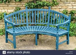 Old Wooden Benches For Sale Blue Wooden Garden Bench Seat In Front Of Old Stone Wall