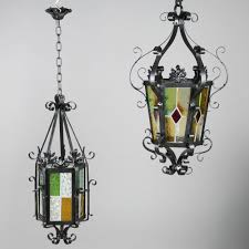 Coloured Chandelier by Two Wrought Iron And Coloured Glass Lanterns 20th Century