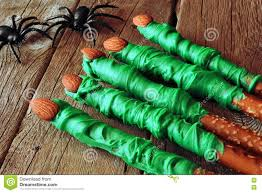 halloween witches finger candy dipped pretzel rods on wood stock