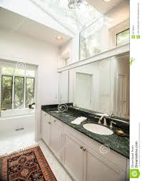 simple modern bathroom with black granite counter stock images