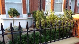 victorian front garden design london stock brick wall and rail