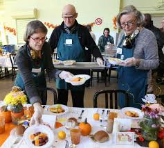 volunteers serve thanksgiving dinner at pine inn boston