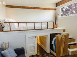 closet under bed tiny houses can also have great storage space