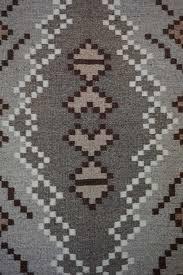 large two grey hills navajo rug with a half snowflake border 928