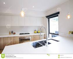 modern kitchen with pendant lighting and sunken sink stock photo