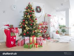 festively decorated home interior christmas tree stock photo