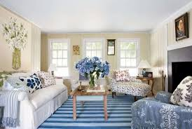 beach theme living room beach theme living room with striped area rug and blue flower vase