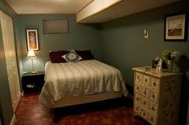 dark green walls in living room black rug double beds rectangular