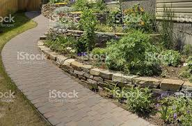 stacked garden walls and flowers stock photo 182810520 istock