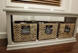 white storage bench with baskets treenovation