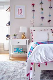 a magical modern bedroom for our growing girl curbly we wanted to stick with clean lines and a bright white color when it came to the furniture in her room but we also wanted to add some warm bronze metallics