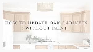 how to freshen up stained kitchen cabinets how to transform oak cabinets without painting them