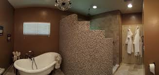 curved shower wall with glass and stone mosaic tile designed by