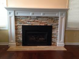 how to decorate double mantels with white wall table and fireplace