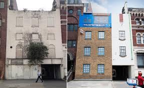 artist plops upside down house in heart of london metropolis