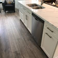 can i put cabinets on vinyl plank flooring can you install vinyl plank flooring kitchen cabinets