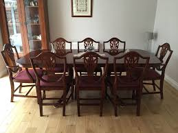 mahogany dining table and 8 chairs beautiful condition in