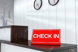check in desk sign check in sign plate on wooden reception desk stock photo picture