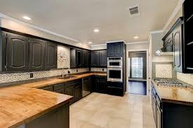 painted black cabinets in kitchen pictures 3 suburban homes where black cabinets are the new white
