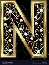 n gold letter with swirly ornaments royalty free vector