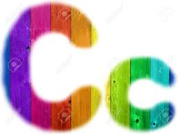 the letter c with a wooden rainbow background stock photo picture