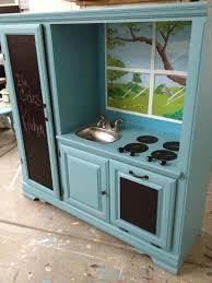 transformed old entertainment center into kids kitchen set we