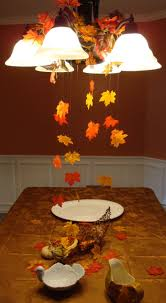decorations for thanksgiving using fishing line and a bag of leaves from from the dollar store