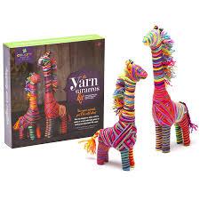 amazon com craft tastic yarn giraffes kit craft kit makes 2
