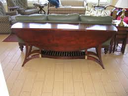 handmade custom floating leg drop leaf oval table by rcwilliams