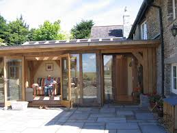 house porch side view oak framed orangery with pitched glazed roof