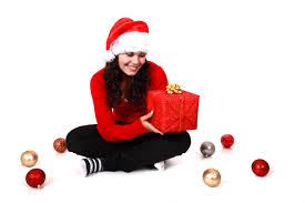 young woman with christmas gift free stock photo public domain