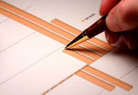 how to write a policy proposal paper cost benefit analysis description graphs on paper and men using a pen to review them