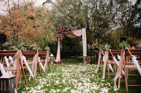 autumnal wedding archway decoration of roses apples grape and