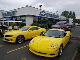 lifted corvette roy robinson yellow 2010 camaro and corvette side by side