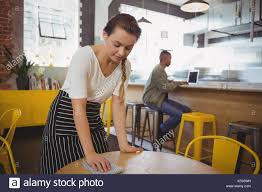 Cleaning Table Stock Images Royalty by Young Waitress Cleaning Table At Cafe Stock Photo Royalty Free
