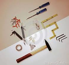 flat lay working tools and light bulb solution concept stock