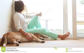 sad woman siting on the floor near the friendly dog stock video