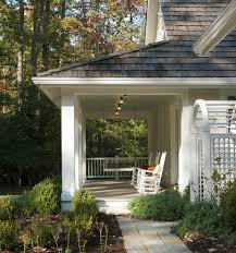 covered porch design covered porch ideas porch beach style with wood roof hanging bench