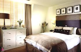 warm paint accent wall colors of small master bedroom design with