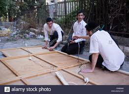 used sukkah for sale religious men are busy erecting a sukkah or tabernacle