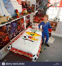 9 or 10 year old boy in his bedroom which is full of kids stuff 9 or 10 year old boy in his bedroom which is full of kids stuff posters and toys