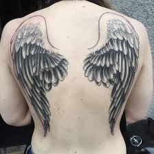 54 photos of wing tattoos