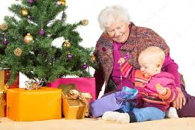 gifts for elderly grandmother gran and baby unwrapping christmas gifts stock photo