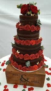 chocolate wedding cakes chocolate tiered wedding cake with handmade roses quality