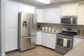 kitchen cabinets antique white cabinets black appliances small