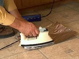 Can You Lay Tile Over Laminate Flooring How To Fix Curling Vinyl Floor Tile How Tos Diy