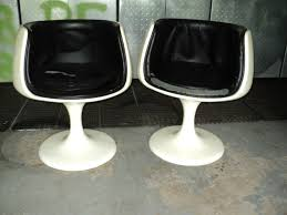 2 space age style barrel shaped tulip pedestal base chairs in